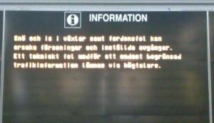 Informationsskylt på centralstationen i Stockholm - förseningar på grund av snö